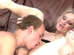 Sexually excited and mad granny named Angeline receives an amazing cunnilingus from her young fucker
