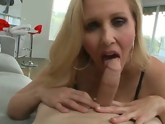 Big titted blond milf Julia Ann knows how to engulf a 10-Pounder in the POV scenes