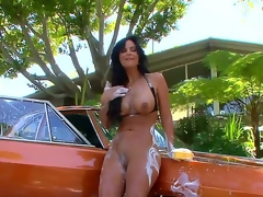 Exceedingly fuckable brunette milf Phoenix Marie is washing a car totally bare and in the process her wobblers and butt receive all soaped up, looking just awesome.