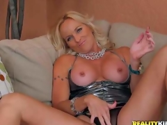 Dani is a flawless bodied golden-haired milf in incredibly hawt short dress. That babe pulls out her awesome round tits and widens her legs wide to play with her mature bawdy cleft in front of the camera