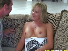 Shes one stylish tall milf blonde with slender figure. That babe acquires enticed by MILF Hunter and goes topless. This woman is proud of her hawt well shaped firm tits. Man licks her nipples juts like insane