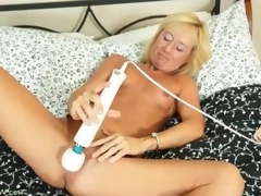 Tight body blonde older gets naked and masturbates