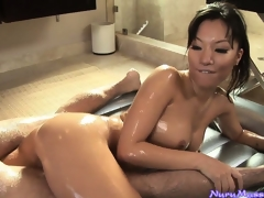 Oriental honey Asa Akira sucking a guy's schlong after a concupiscent nuru massage