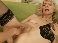 Golden-haired mature gets fisted and dildoed with a atypical