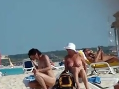 Naked mature wife gets a stranger to rub sun lotion on her back, tiny bazookas and little hair visible.